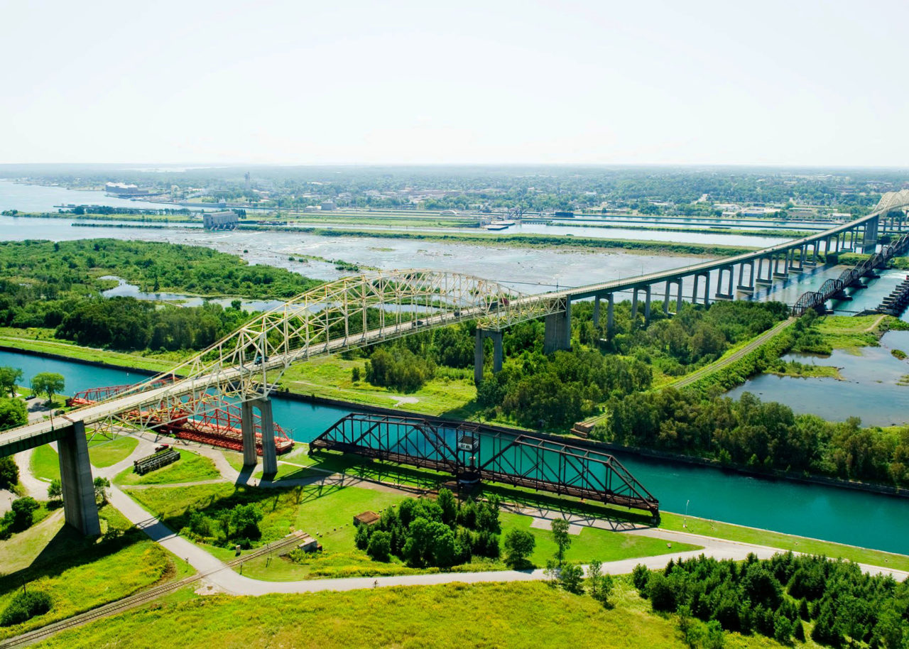 An aerial photo showing the International Bridge in Sault Ste. Marie, towering over the canal.